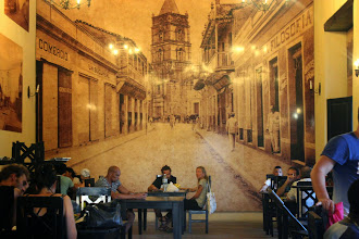 Photo: Café Ciudad with the painting of the street which originally brought in this place