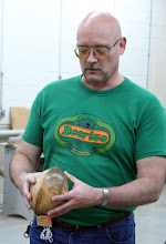 Photo: Don Van Ryk with a pair of spalted maple bowls from the same log -- showing their original positioning in the raw material...