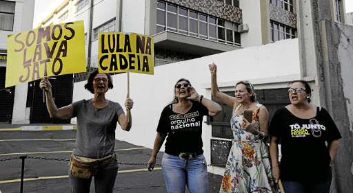 People react after billionaire Joesley Batista, one of the owners of meat packer JBS, and executive Ricardo Saud were arrested in São Paulo, Brazil, on September 10 2017. Picture: REUTERS