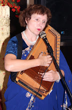 Photo: Linda Hamilton whistling accompanied by her Autoharp