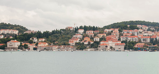 Dubrovnik-shoreline.jpg -  The coastline of Dubrovnik harbor on an overcast day.