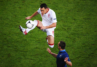 Photo: John Terry of England controls the ball during the UEFA EURO 2012 group D match between France and England at Donbass Arena on June 11, 2012 in Donetsk, Ukraine.
