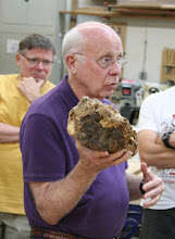 Photo: Bill Long contemplates what to make out of his burl.