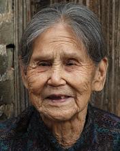 Photo: Smiling woman, China