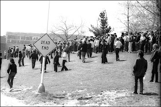 Photo: Students across the street from the guard that are trapped by the fence in the practice football field.