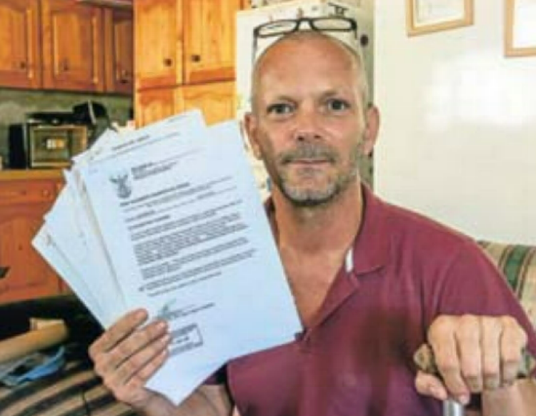 Maurice Pirzenthal with police documents detailing his mother's alleged misbehaviour. File photo