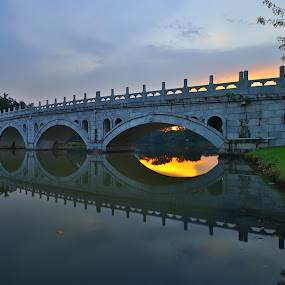 Bridging by Chester Chen - Buildings & Architecture Bridges & Suspended Structures ( reflection, sunset, stone, bridge, japanese, jurong lake, garden, chinese )