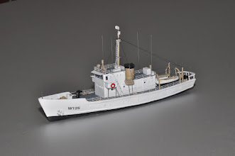 """Photo: The 125' Active vclass cutters served from the late 1920s into the 1970s. This exquisitely detailed model shows a later configuration, with fewer scuppers (portholes) along the length of the hull, and custom photo-etched railings with correct stanchion spacing. Also available in a full hull model. This little gem is only 9.4"""" long and will fit even in small harbors or riverside scenes. Every detail is meticulously to scale."""