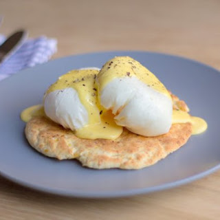 Poached Eggs on a Corn and Parmesan Flatbread with a Hollandaise Sauce.