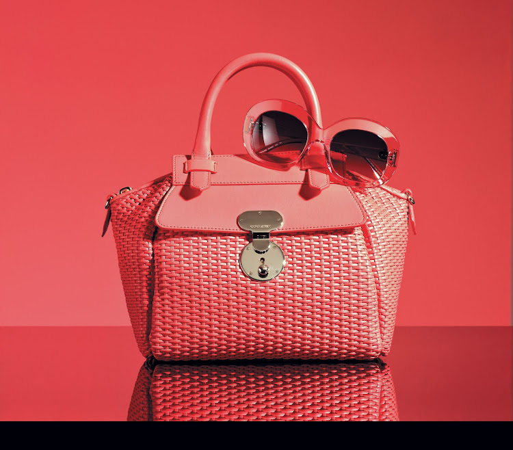 Bauletto bag in pomegranate woven calfskin, R39 995; Sunglasses R3 795, both Giorgio Armani