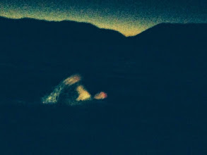 Photo: Chandra's picture of him swimming just before sunrise.