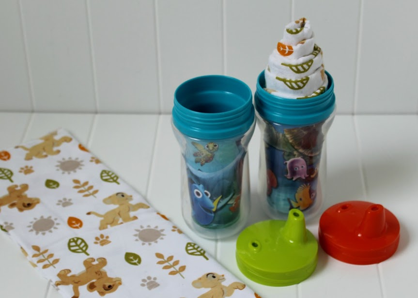 "Make cute Disney Baby ""Milkshakes"" by rolling up Lion King receiving blankets and tucking them into Finding Nemo sippy cups! Really easy DIY baby shower gift idea"