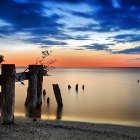 dawn at Fifty by Andrzej Pradzynski - Landscapes Waterscapes ( smooth, glare, posts, long exposure, lake, beach, morning )