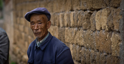 Photo: Exploring Along the Earthen Bricks  This is one of those little things that I like so much about China... the people are so interesting for photography. They are often confused when I take their photo, because they find themselves quite plain and uninteresting. After I show them the photo, they are always happy and excited, while still being a bit flabbergasted at the whole experience. But, even though it is a strange interchange, it's a nice one.  #SICInDatabase