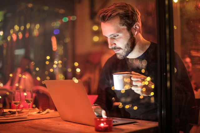 man at open laptop getting ready to start an online business today