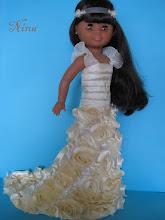 Photo: Precioso vestido de novia para nancy modelo Bohéme.  Realizado en color cava, con flores en relieve en la falda, cuerpo plisado y tirantes plisados en el mismo tono.  Lo completa tocado para la frente con ambas flores laterales en el mismo tono del vestido.  Precio: 28 euros más envío.