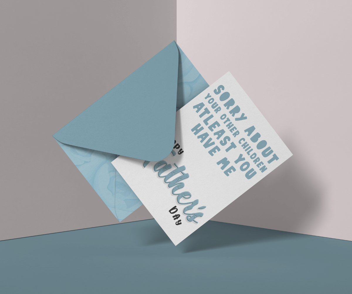 """White Father's Day card with the phrase """"sorry about your other children, at least you have me"""" written in light blue text. Next to a light blue envelope."""