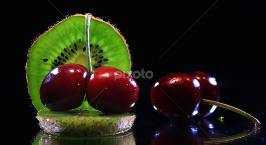 by Dipali S - Artistic Objects Other Objects ( cherry, reflection, fruit, red, food, green, kiwi, slice )
