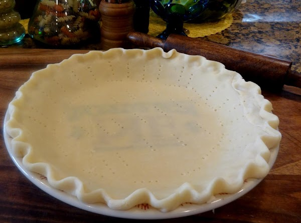 Make your pie crust, pinch the edges as in my photo. Prick the crust...