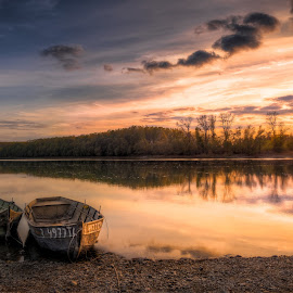 boats in sunset by Cornelius D - Transportation Boats