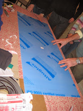 Photo: Preparing to attach the magnetic  strips to  the Acrylic sheet