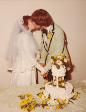 Photo: Kiss behind the cake.