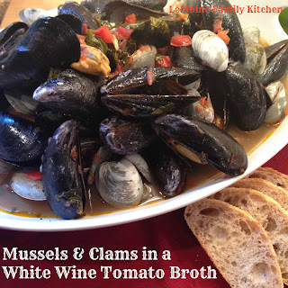 Mussels & Clams in a White Wine Tomato Broth.