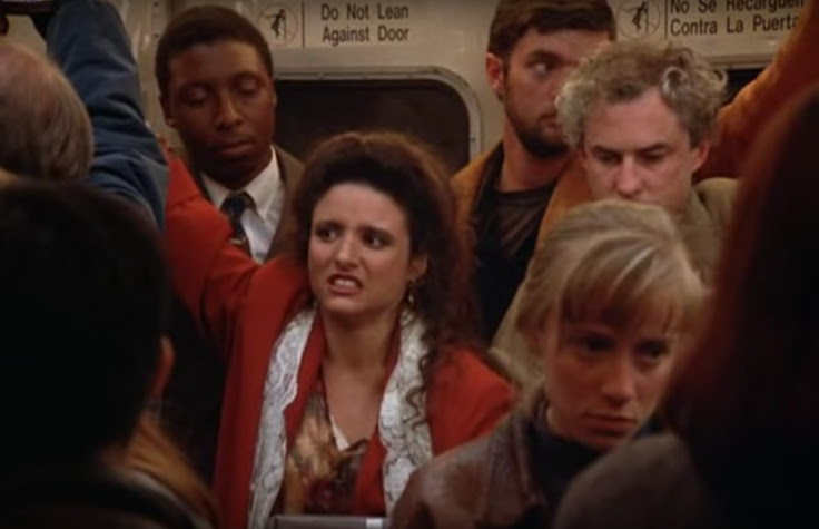 Elaine on the subway.