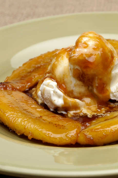 Flambé Desserts: Bananas Foster is a classic dessert featuring vanilla ice cream.