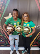 Striker Thembi Kgatlana (L) and coach Desiree Ellis (R) pose with their Caf Awards.