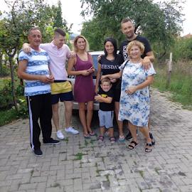 Family  by Viktorija Spasenoski - People Family ( woman, man, family, holiday, day, boy, trees,  )
