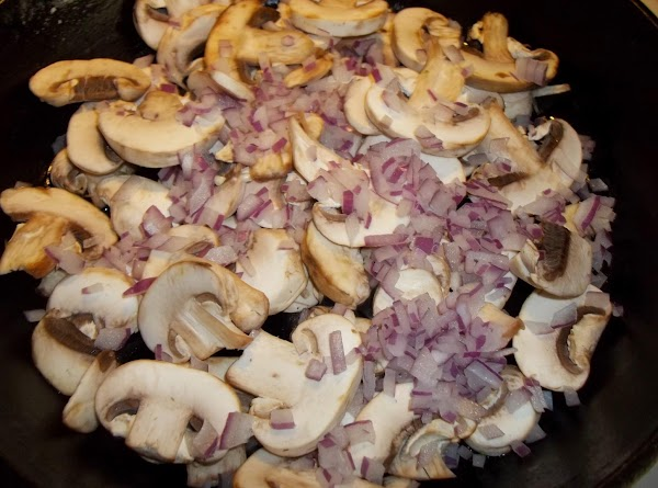 In a medium skillet, brown the mushroom and diced red onions until tender. Set...