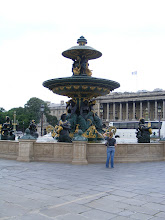 Photo: The main fountain on the square. In the background is the Crillon Hotel, one of the city's most fashionable and expensive.