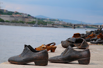 Photo: The Shoes on the Danube Promade was created by a man named Gyula Pauer and is a memorial on the bank of the Danube in Budapest. It is a memorial to the people who fell victim to the Arrow Cross Militiamen in Budapest and depicts their shoes left behind as they were cast into the river after having just been shot during WWII. There were shoes of men, women and children, including the shoes of a toddler posted above.During WWII between 250 and 400 workers worked around the clock to prevent its Jewish population from being sent to the many concentrations camps that marked the war. They were housed at the Swedish Embassy and other buildings in the area. On January 8, 1945 all of the inhabitants were rounded up and taken away to the banks of the river by the Arrow Cross Execution Brigade. Still wanting to prevent a massacre, 20 policemen armed with bayonets rescued them all, and helped them to flee the country.