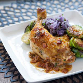 Pan-Seared Chicken Legs with Purple Potatoes, Brussels Sprouts & Bacon Vinaigrette.