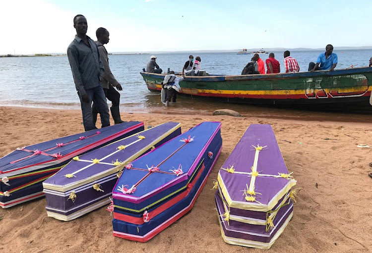 Volunteers arrange the coffins containing the dead bodies of passengers retrieved after a ferry MV Nyerere overturned off the shores of Ukara Island in Lake Victoria, Tanzania September 22, 2018.