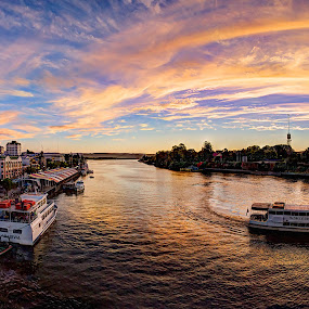Boats on the Valdivia River  by Charles Brooks - Transportation Boats ( water, skyline, aerial, boat, mancera, los rios, city, marques, chile, valdivia, ripples, sunset, south america, bridge, pollux, river )