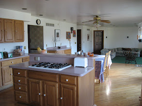 Photo: Kitchen island and dining room