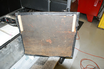 Photo: Front seat removed to show wooden cleats added to the underside to secure the seat in position during use.