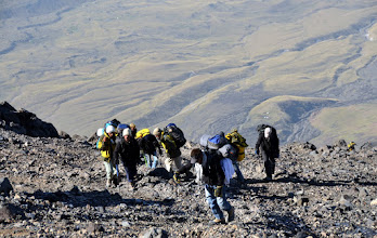 Photo: Kurdish porters making their way up the rock pile