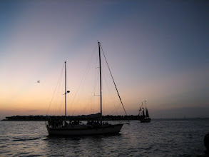 "Photo: Sunset in Key West is a part of the tourist industry. There are plenty of boats who take tourists on a ""sunset cruise"" in the harbor"