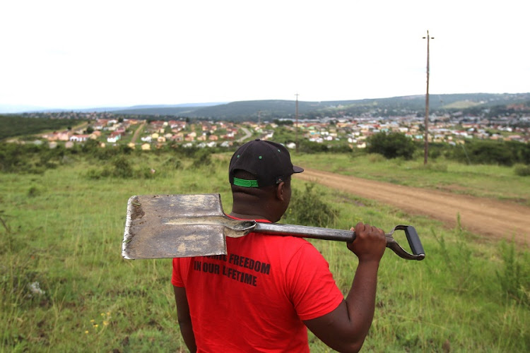 Land grabs have been gaining ground around the country. Mziyanda Hlekiso is seen in action at some open land above Ginsberg, in the Buffalo City Metro. Picture: MICHAEL PINYANA/Daily Dispatch