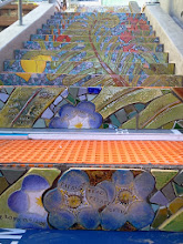 Photo: Foreground: detail of the top step of the third flight of the Hidden Garden Steps (16th Avenue, between Kirkham and Lawton streets in San Francisco's Inner Sunset District), installed on October 29, 2013. KZ Tile workers finished installing more than 36 pieces of the 148-step ceramic-tile mosaic designed and created by project artists Aileen Barr and Colette Crutcher. For more information about this volunteer-driven community-based project supported by the San Francisco Parks Alliance, the San Francisco Department of Public Works Street Parks Program, and hundreds of individual donors, please visit our website at http://hiddengardensteps.org.
