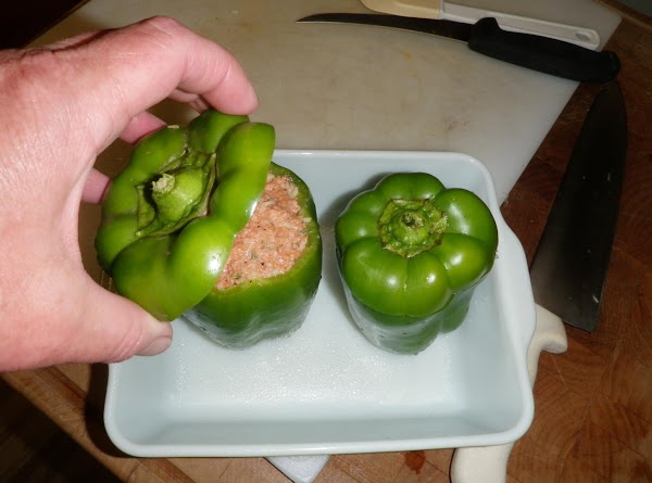 Fill the bell pepper with the bologna mix and cap with the pepper lid....