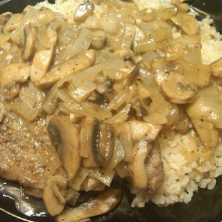 Cheap Steak With Mushroom Sauce and Brown Rice.