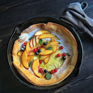 Dutch Baby Pancake with Baked Pineapple, Topped with Peaches, Blueberries & Currants
