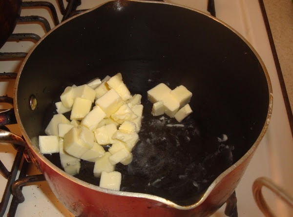 In a large saucepan, bring the water, butter and salt to a boil over...