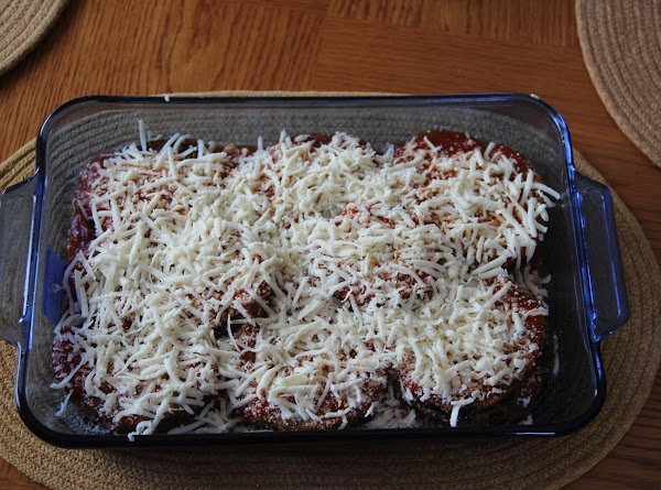 Once the eggplant and sauce are in the dish, sprinkle the parmasan and mozzarella...