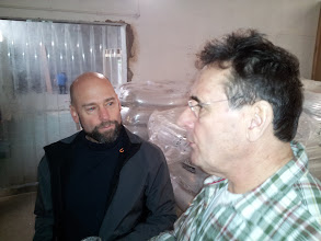Photo: Bob Sandange discusses the brewing process with Hawkshead's Alex Brodie.