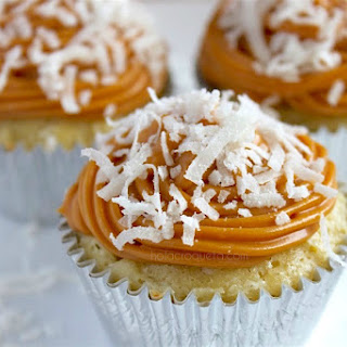 Guava Cheese Vanilla Cupcakes with Dulce de Leche Frosting and Coconut Flakes